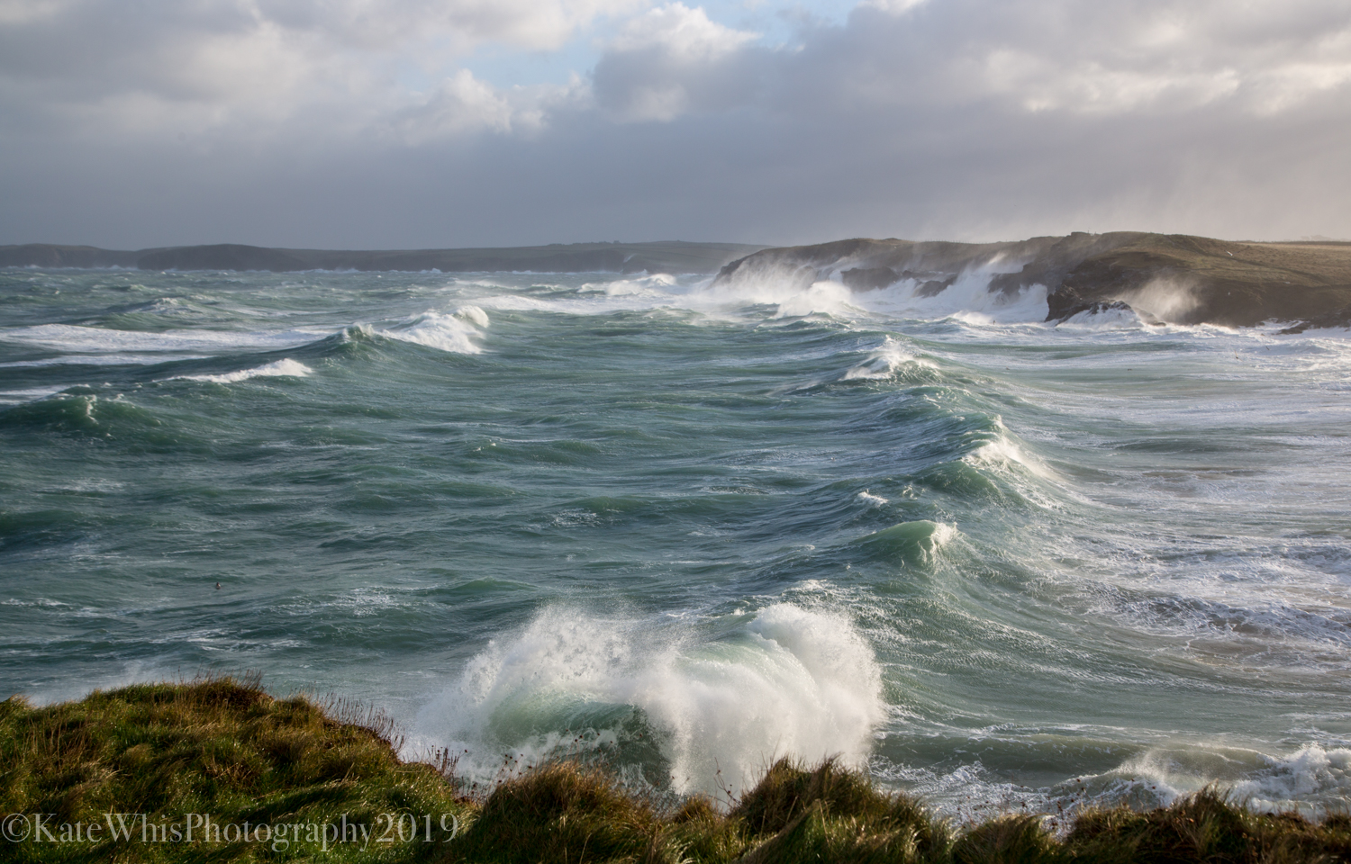Big waves breaking into the bay at Mother Ivey's Bay