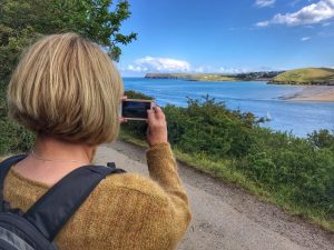 Client using her smart phone on my guided photography walk