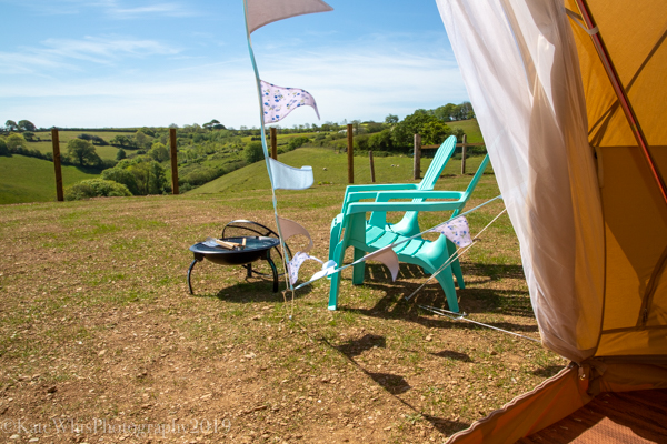 Looking out of the bell tent door