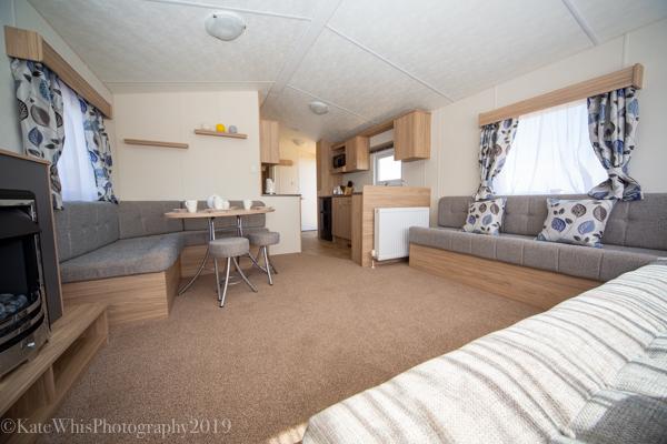 Living room in a caravan at The Oaks