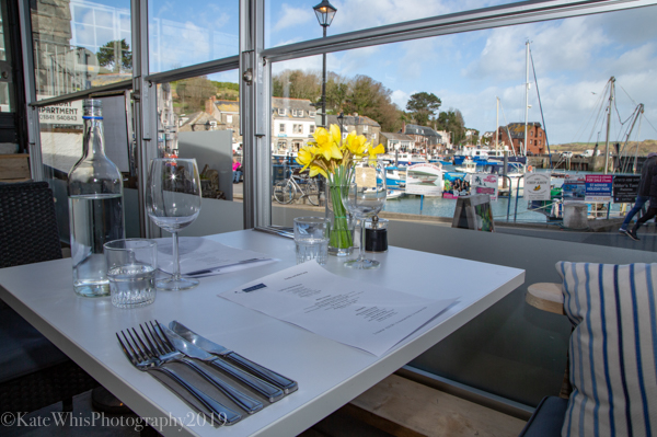 view of Padstow harbour from inside The Basement resturant
